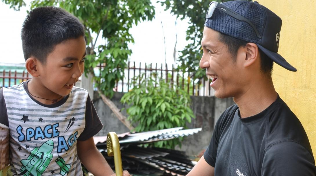 Projects Abroad intern and child pictured sharing a happy moment during his occupational therapy internship in the Philippines.